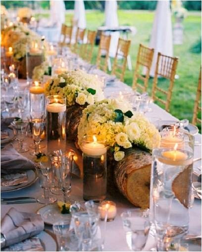 If you are looking for an interesting centre piece for a rustic themed wedding why not try mixing wooden logs with flower arrangements.