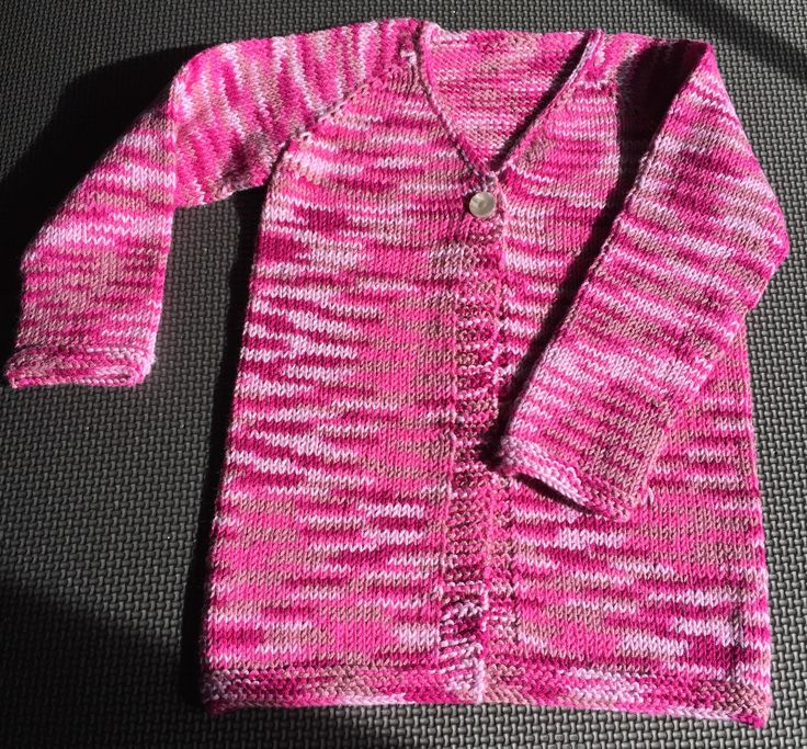 """Knitted sweater for Clara, size 2.  Used """"Bamboo Pop"""" yarn.  It is a combination of bamboo and cotton."""