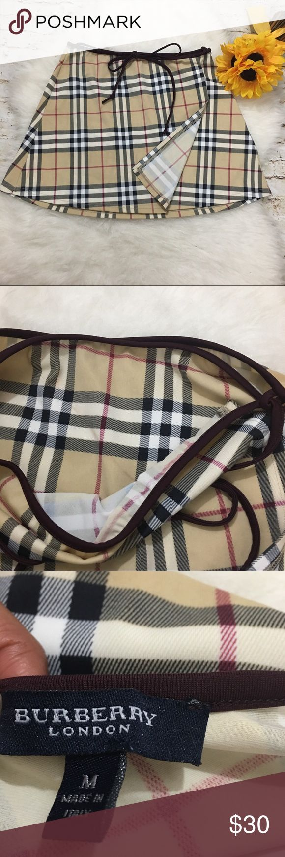 Burberry Wrap Around Sarong Swim Skirt M In good condition, but does have some staining. Nothing too noticeable please see pics. Burberry Swim Sarongs
