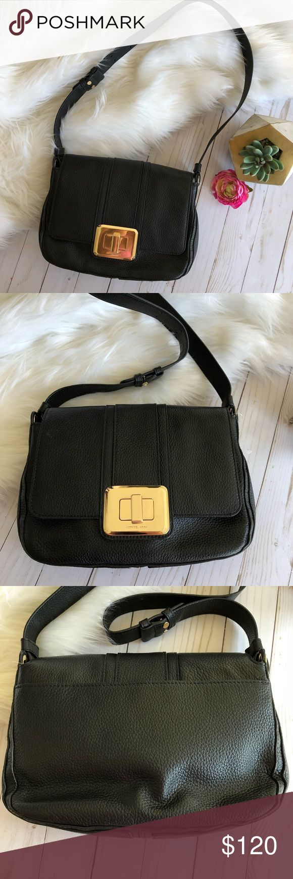 "Michael Kors Black Leather Purse Beautiful pebbled leather shoulder bag adorned with gold hardware. Features a front clasp closure. Does have scratches on the clasp from normal wear. Leather and interior are in excellent condition. Measurements: width 11"" height 8"" strap 34"". Michael Kors Bags Shoulder Bags"