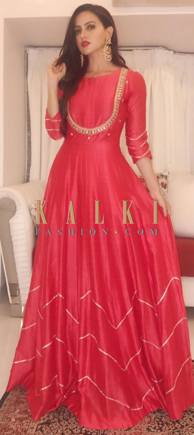 Buy Online from the link below. We ship worldwide (Free Shipping over US$100) Click Anywhere to Tag Sana Khan in tomato red modern and traditional gown only on Kalki This tomato red full length silk dress is a perfect blend of modern and traditional design. It has golden detailing at the bodice as well as the hem. This outfit makes for a perfect Indo-western look!