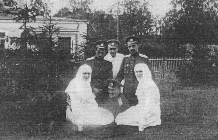 "Grand Duchesses Tatiana and Olga Nikolaevna Romanova of Russia as Sisters of Mercy.Dmitry Shakh-Bagov is at Tatiana's right. ""AL"""