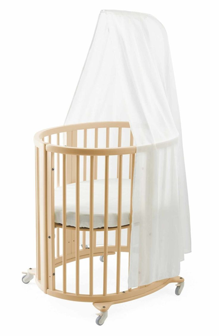 Cute oval baby crib ideas | Sleepi Mini Crib, Drape Rod & Mattress Bundle http://shopstyle.it/l/cP9L | Cradle your newborn in a beautiful oval-shaped beechwood mini crib that's a masterpiece of minimalist Scandinavian design. With four  adjustable mattress positions, it accommodates your growing baby as well as remains easy on your back as you bend in to retrieve your little  one. {Ad}