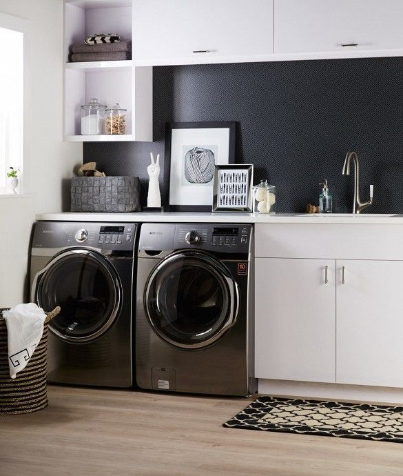 Black patterned wallpaper in laundry room