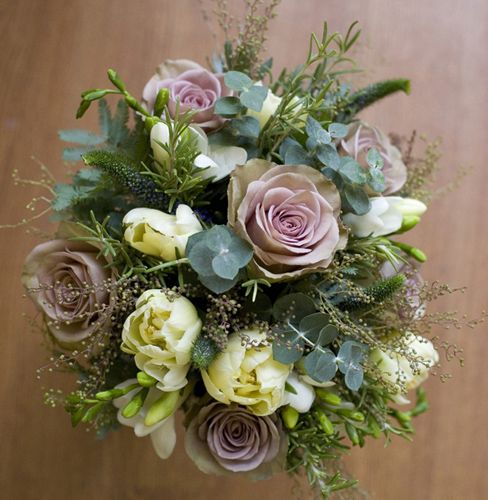 Hand-tied bouquet including Amnesia roses and tulips with silvery eucalyptus and herbs
