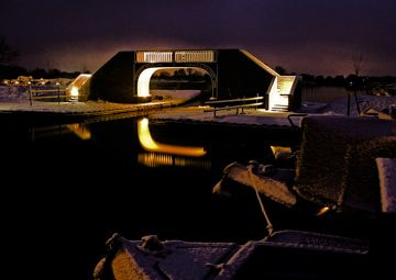 The bridge between the Locks and Meadows marinas at Calcutt Boats beautifully backlit under a night sky in winter. www.calcuttboats.com www.calcuttboatsshop.com