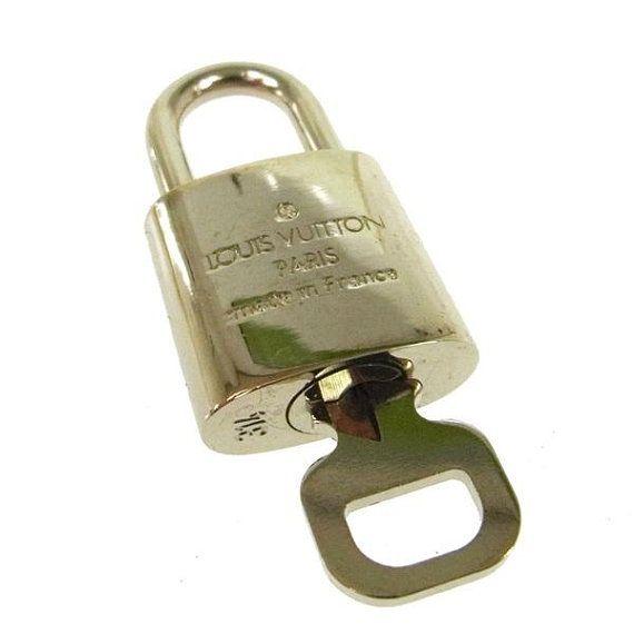 Authentic Silver Louis Vuitton padlock Silver LV lucchettoLv