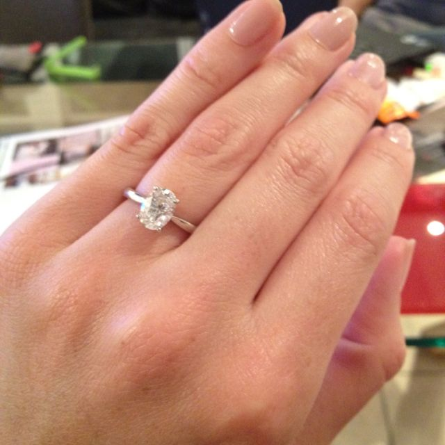 Oval cut engagement ring, the best cut. if this was gold or rose gold, this would be PERFECT