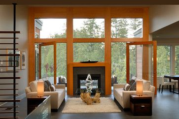 Love dual sided fireplaces between the living and porch areas... gorgeous.