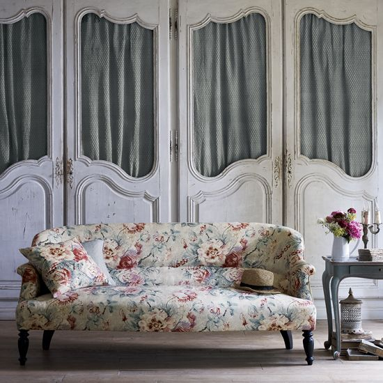 Floral sofas are back in style. Learn how to work the trend in your home with Ideal Home's decorating tips.
