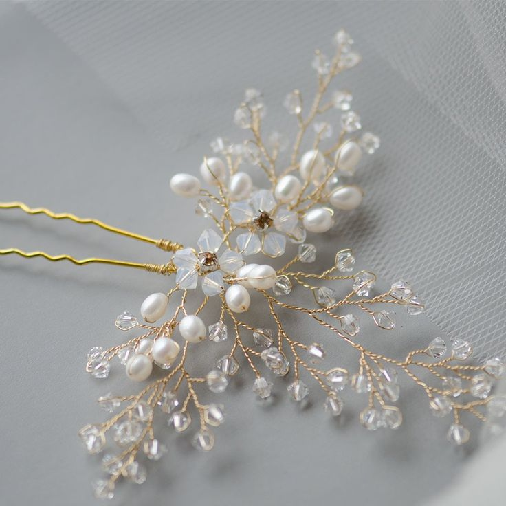 Swarovski Clusters And Pearls Bridal Pin. This handmade bridal headpiece, in soft gold tones, is handcrafted using traditional millinery tools and techniques. The piece is decorated with numerous clear and opal Swarovski elements and pearls, intricate to one another, detail and dainty, perfectly adorns a range of bridal hairstyles on wedding day.