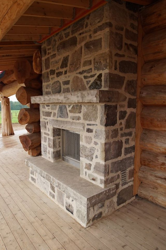 The home features a two-sided fireplace in the great room which opens on the other side to the porch.