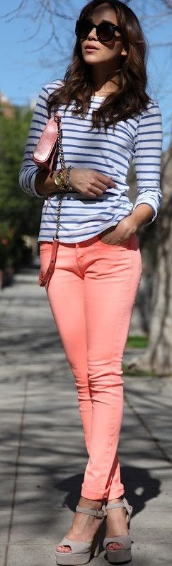 Bright and cherry pastel pink/light salmon colored jeans. Skinny jeans, striped shirt, Parisian style.