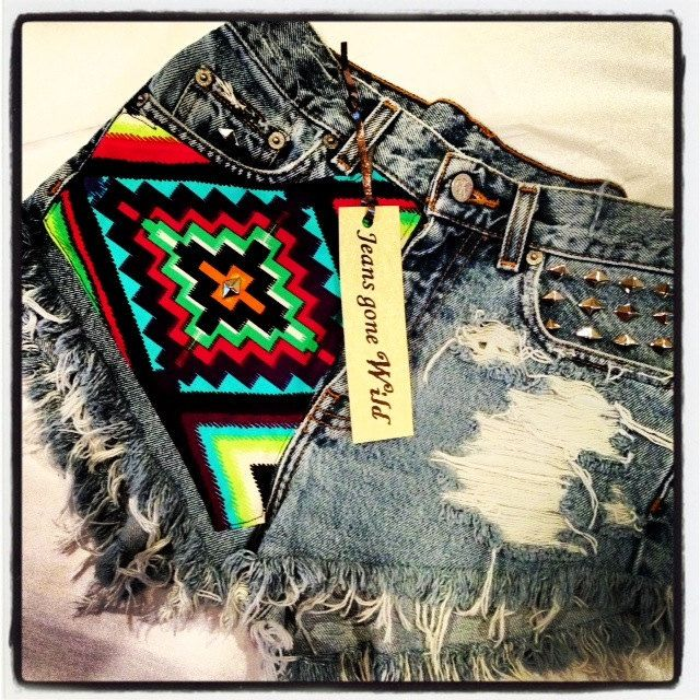 High waisted destroyed denim shorts super frayed with tribal motif size via Etsy.