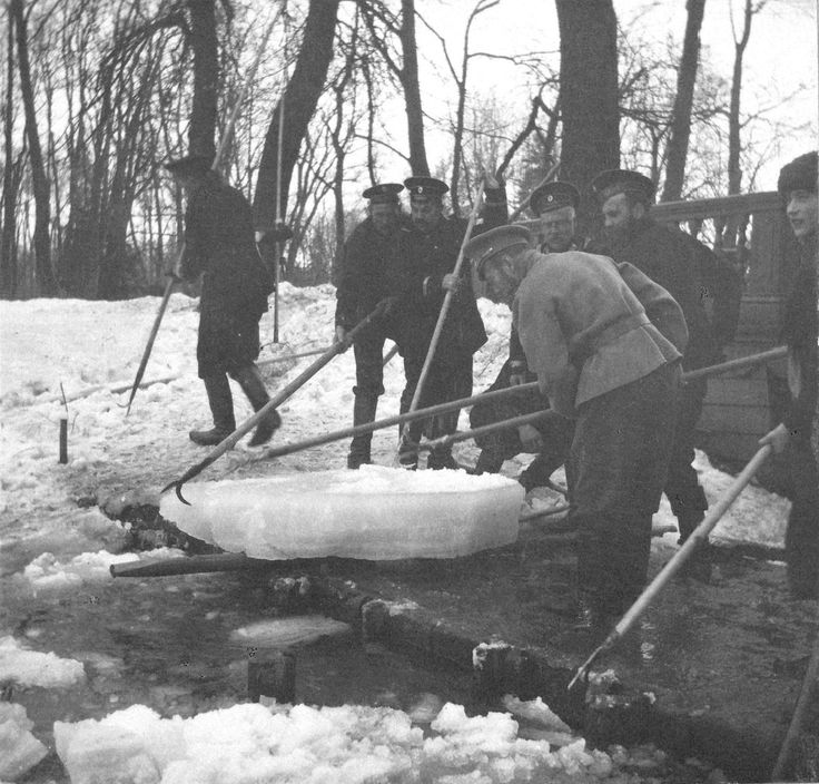 Tsar Nicholas II with his youngest daughter Grand Duchess Anastasia and others clearing the ice from the canals at Tsarskoe Selo, 1915