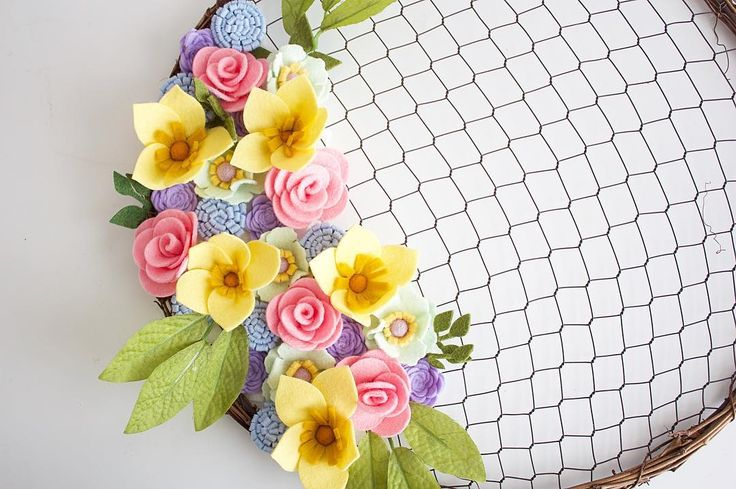 Not even going to try and think of a dumb catchy caption, why is it so hard!?! So instead here's a really pretty and springy chicken wire wreath. Happy I thought it was Friday! #ineedanap #andavanillacoke #jadewithlove #madewithlove #handmade #handmadeisbetter #shophandmade #springwreath #feltflowerwreath #feltflowers #feltaddict #etsy #etsyseller #etsyshop