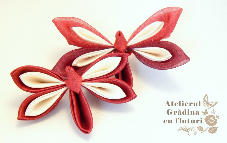 Red satin and organza kanzashi dragonflies on hair clips.     Libelule vişinii din satin şi organza pe clame de păr.