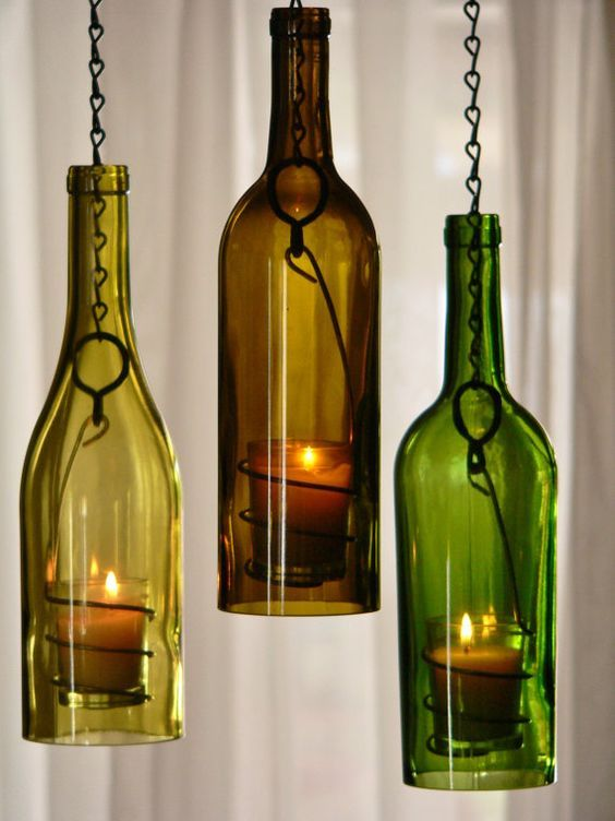 Repurposed wine bottle hanging candle lanterns: