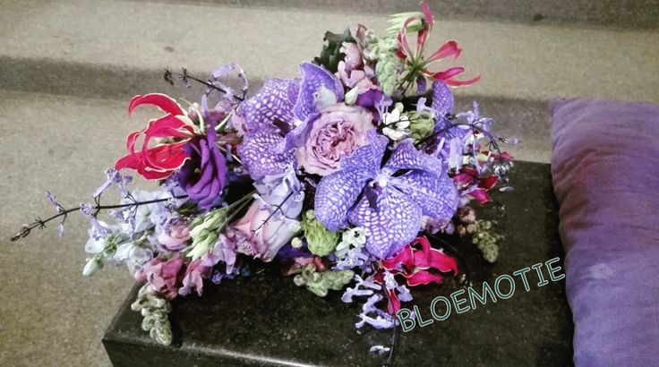 Wedding bouquet in purple and touch of pink