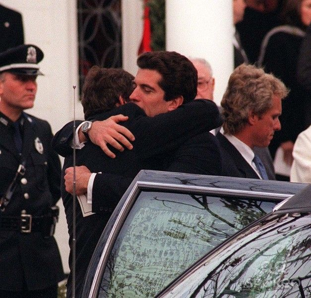 Funeral of Michael Kennedy.  John Kennedy Jr and William Kennedy Smith embrace.