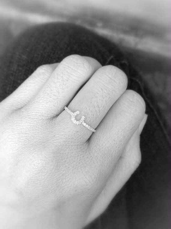 Cute and simple Horseshoe Ring with a bit of bling...  Width of Horseshoe measures 6mm  Made with Sterling Silver 925  Thanks