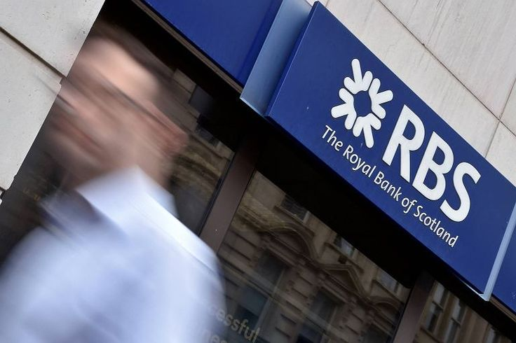 IA man walks past a branch of The Royal Bank of Scotland in central London
