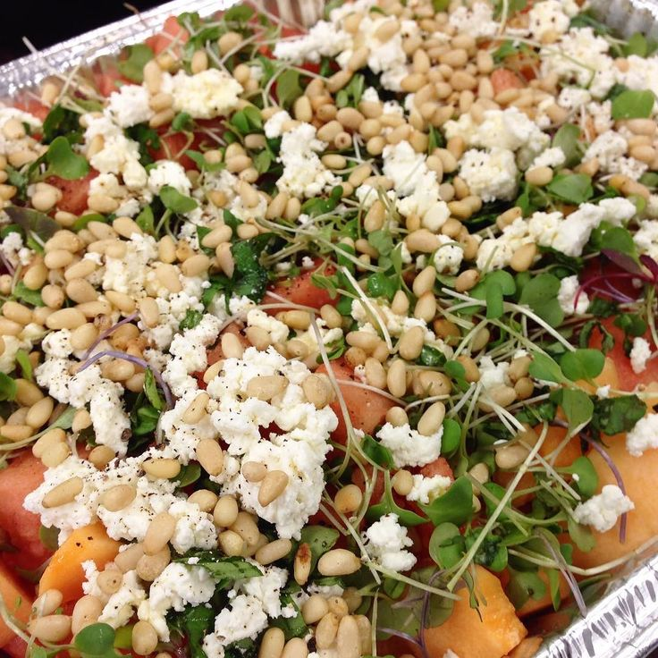 This was my contribution to a work potluck :: a watermelon cantaloupe salad with micro-greens basil pine nuts goat cheese & an orange Muscat champagne dressing. Thankfully it was a hit. #potluck #watermelon #cantaloupe #microgreens #goatcheese #pinenuts by gourmetgeek