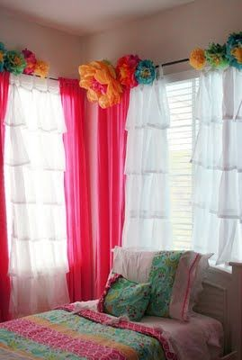 I like the idea of flowers or pom poms on curtain rod