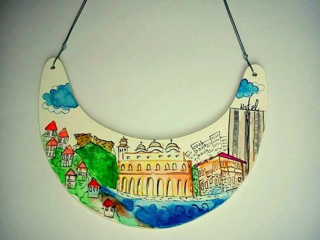 Aleksandra Ivanova jewelry, Personalized Cityscape Necklace, Personalized Jewelry, City Skyline, Statement Necklace, Architectural Jewelry necklace on wood panel with gesso painted with colored pencil and watercolor  #sofijafiligranska #illustration #watermelon #brooch #earrings #necklace #jewellery #jewelry #contemporaryjewelry #joya #bijuteriecontemporana #bijoux #joyeriacontemporanea