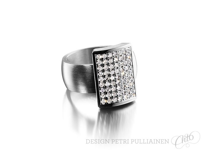 Stainless steel ring with 63*0.015 diamonds. Photo Mikael Pettersson.