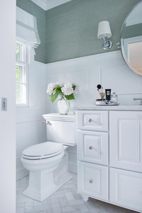 A pretty bathroom in seafoam green and whites. Per ...