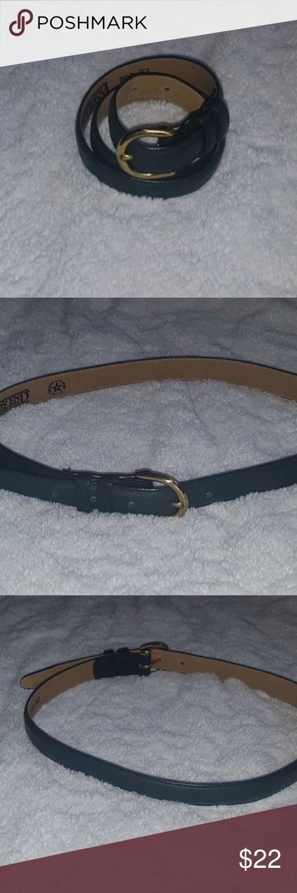 "Lands' End Size 28 Waist Womens Belt Green Leather Lands' End Size 28 Waist Womens Belt Green Leather Solid Brass Buckle   Never worn belt. Only sign of use is the bend from where it was stored, see photo.   Width 7/8""  Length from buckle to end 33 7/8"" Lands' End Accessories Belts"