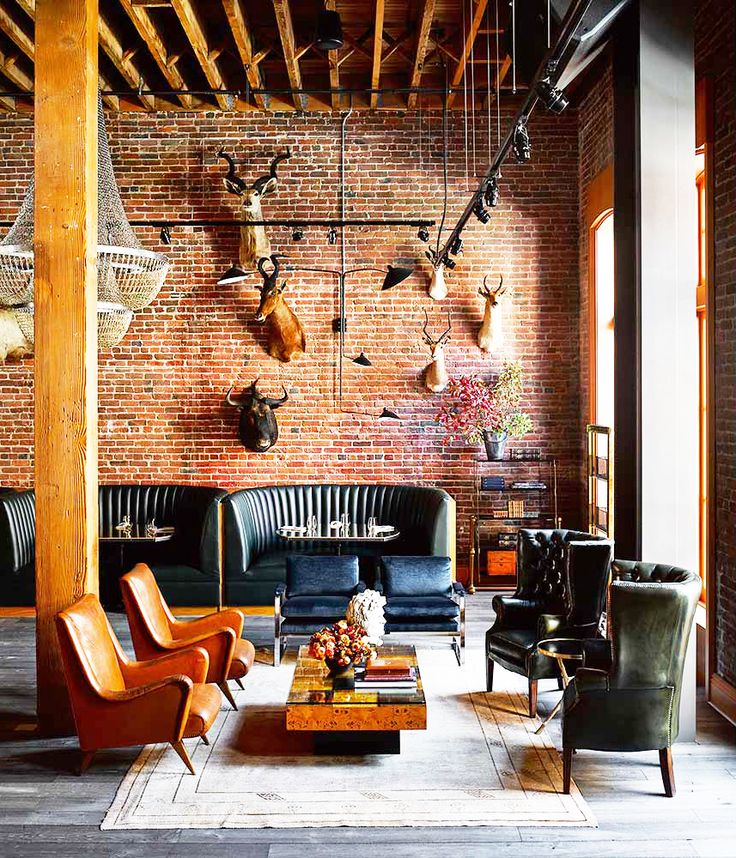 Handsome and masculine living space with lots of leather and brick