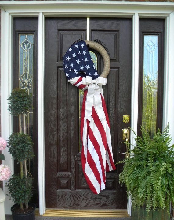 American Flag, Patriotic Wreath with Bow, wreath form is a 18, jute wrapped, straw wreath. Flag is Poly/Cotton, made in America, and bow is