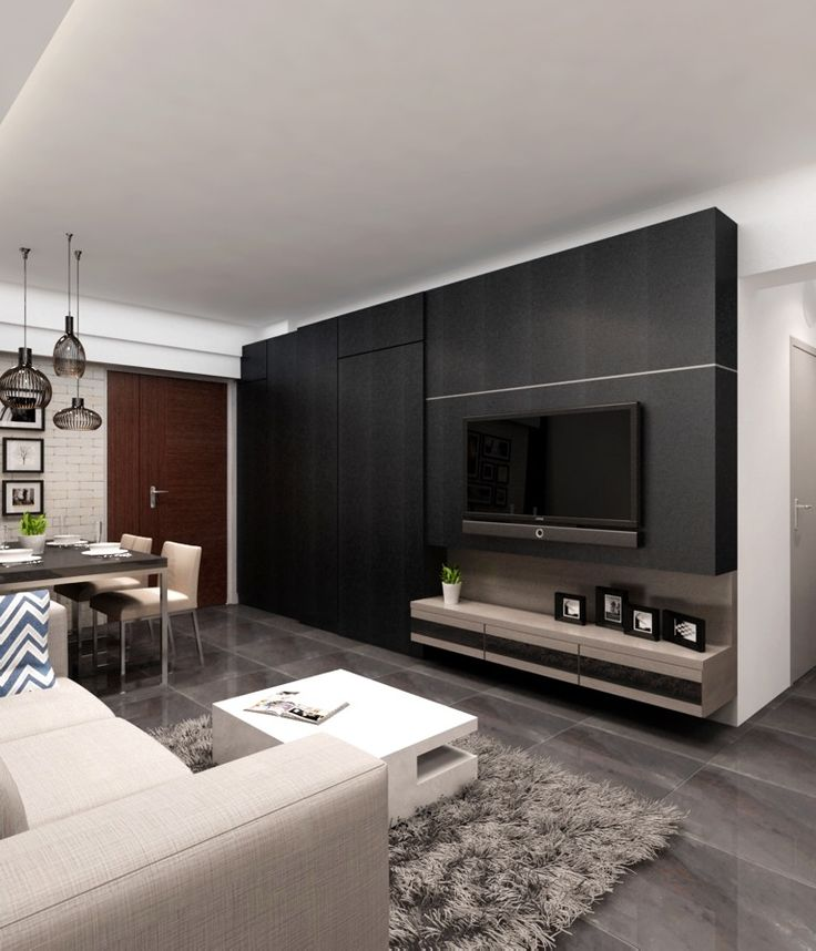 The living area features many gems, like the platform that distinguishes as a separate room. Or the TV feature wall, which is as dramatic as possible, with hidden storage in it. Or in the dining area, the mirror that reflects the whole table. The living area of the apartment has everything, but the main theme …