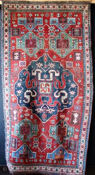 Extremely colourful and very old chondzoresk rug, lovely deep aubergine. Filthy dirty and with quite a lot of well matched 'Granny stitch' filling in some of the worn areas, particularly the bottom  ...