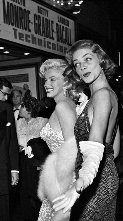 Marilyn Monroe & Lauren Bacall outside the theater at a showing of How to…