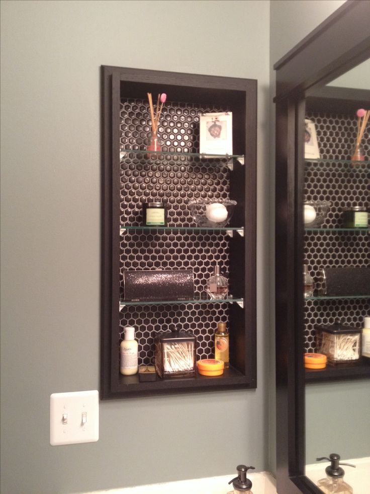 glass shelving to replace medicine cabinet; black hex tile backing