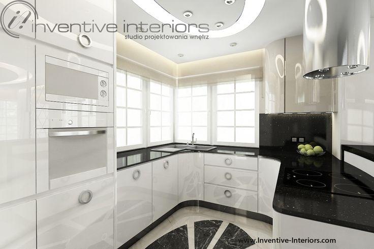 Projekt kuchni Inventive Interiors - biała luksusowa kuchnia z czarnym blatem