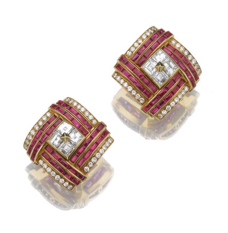 PAIR OF RUBY AND DIAMOND EAR CLIPS, BULGARI. Each square clip set with lines of calibré cut rubies and brilliant-cut diamonds, the centre mounted with step-cut diamonds, mounted in gold, clip fittings, signed Bulgari, Italian assay and maker's marks.