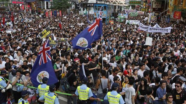 Protests greet new Hong Kong leader Leung Chun-ying