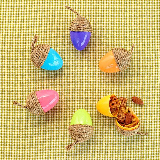 Leftover Easter eggs are just what your fall party needs. Use hot glue to attach…