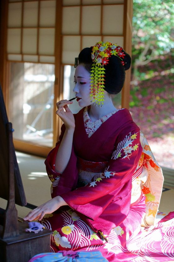 Japan - Maiko Putting on Make-Up in Front of Mirror
