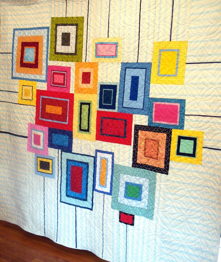 """Fun """"Modern City Quilt"""" by Nancy Tanguay. I really like the thin black lines that extend to the edges of the quilt."""