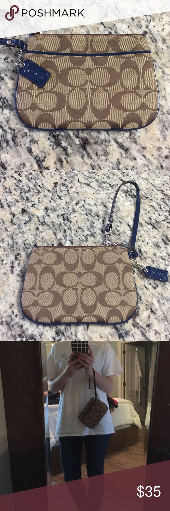 Coach clutch Brown with navy accents. Never used. No tags. Coach Bags Clutches & Wristlets
