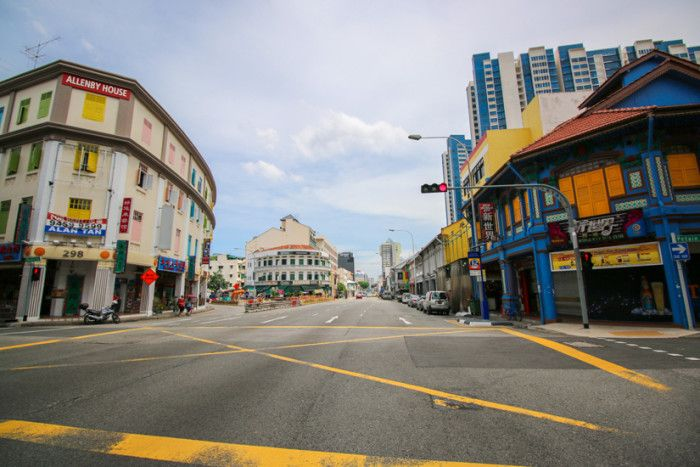 Jalan Besar: a town of competing social forces. Samsui women and hipster ladies; turn-of-the-century shophouses and gentrified cafés; one-room flats and the Sports Hub; and ancient history and modern history.