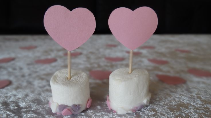 Valentine Treat - Marshmallows with icing and sprinkels. Recipe:  Marshmallows Icing Sprinkels  Heart on a toothpick