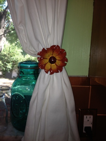 DIY curtain tie backs using a Pier 1 Embossed Metal Sunflower Napkin Ring