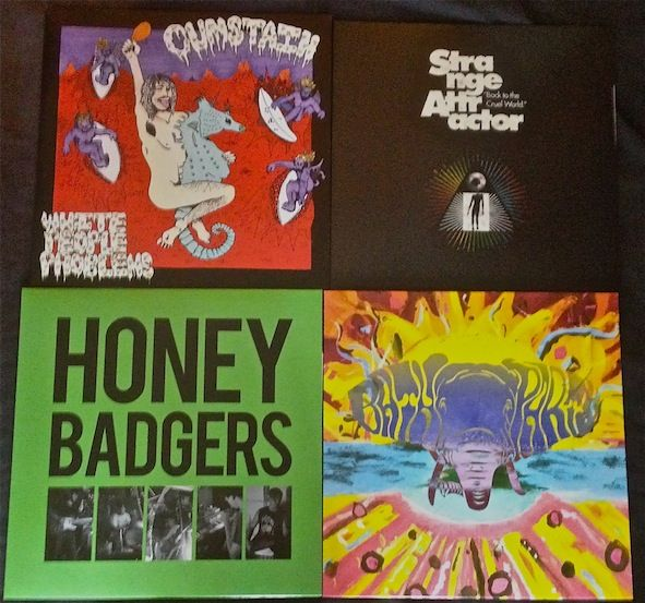 New releases from RESURRECTION RECORDS has just turned up. LP's from CUM STAIN, THE HONEY BADGERS, TRANGE ATTRACTOR and BATH PARTY ( mess up psych rock)