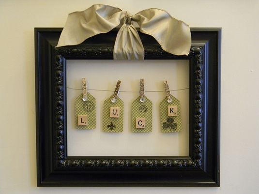 Tags.....clothespins.....frame.....St. Patrick's Day decor...Those are Scrabble tiles!
